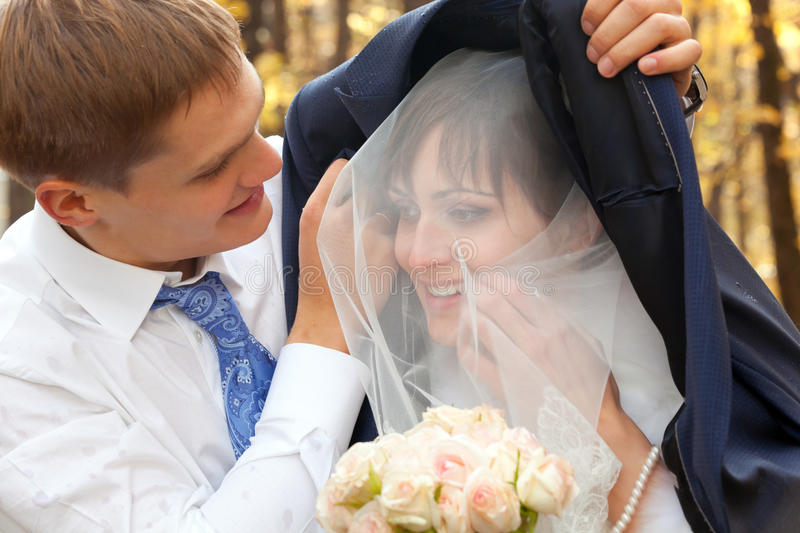 Groom Protecting Beautiful Bride Stock Images