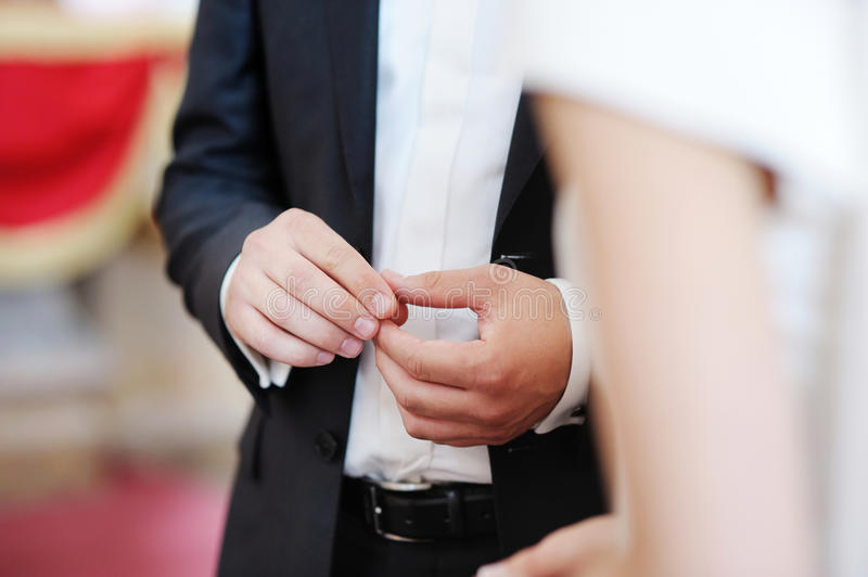 Download Groom Putting A Ring On Bride's Finger Stock Photo - Image of engagement, gold: 20703690