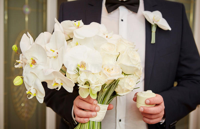 Groom with rings and bouquet stock photography