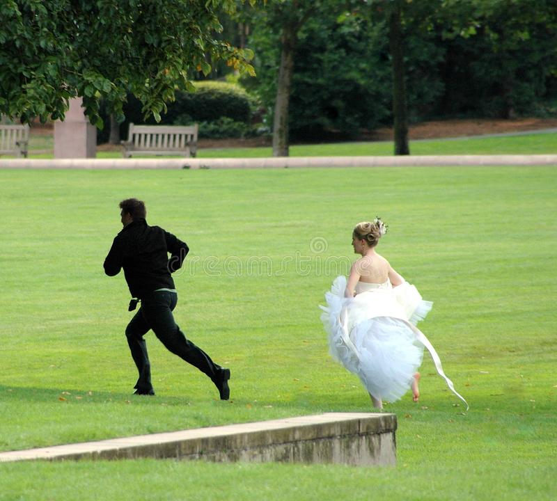Groom running away. SEATTLE, WA. AUGUST 11, 2007. CIRCA: Groom running away from his bride after changing his mind about getting married
