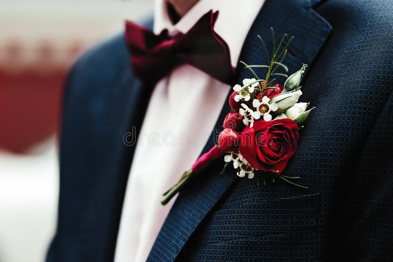 Groom`s boutonniere on the jacket royalty free stock photography
