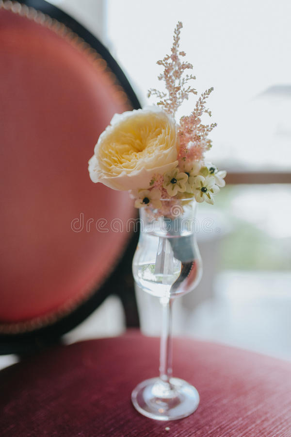 Groom`s orange blossom with rose and wild flowers. Waiting for groom in a glass of water stock photo