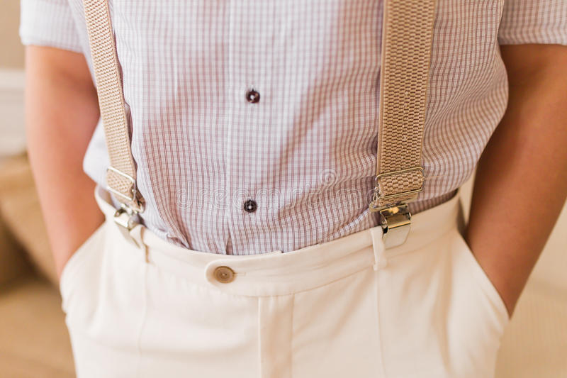 Grooms suit. Elegant white grooms suit close up with a shirt and pants royalty free stock photo
