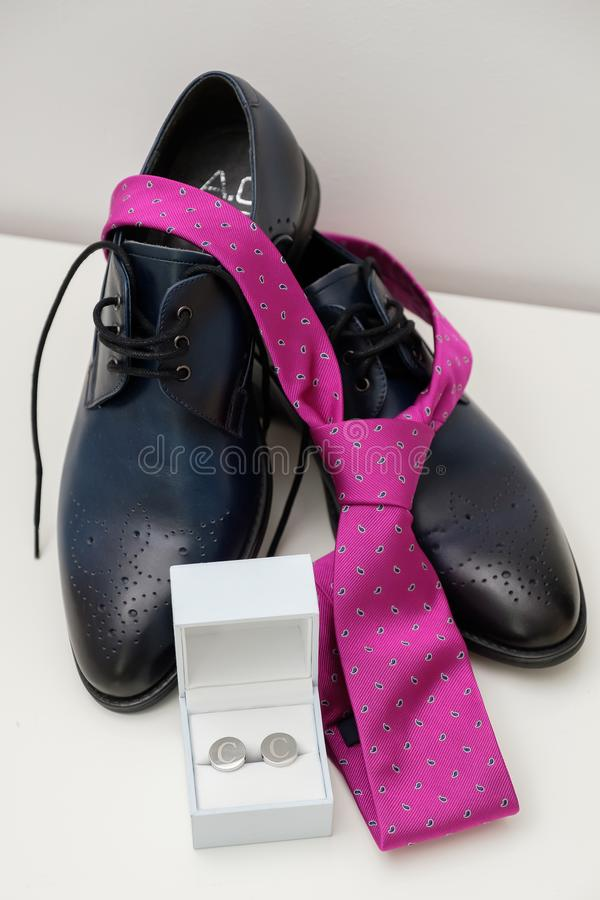 Groom shoes, pink tie stock photo