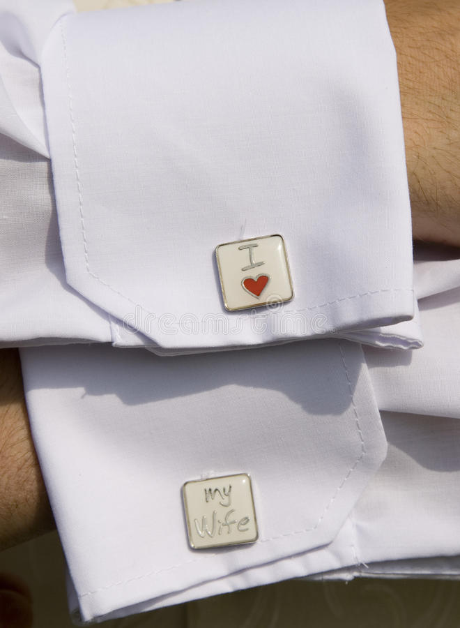 Groom showing off his cuff links. Photo of a groom displaying his detailed cuff links royalty free stock photos