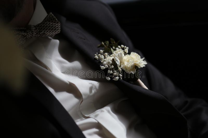 Groom white shirt suit black butterfly flower accessories stock photos