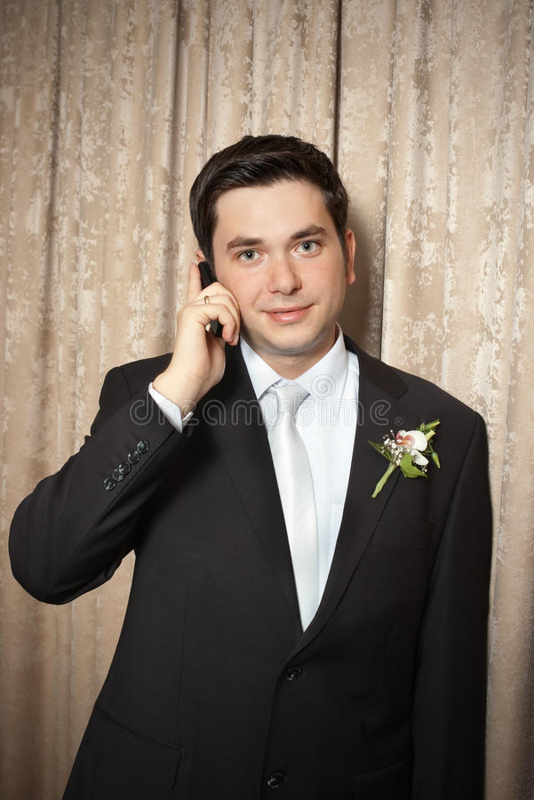 Download Groom speaking on mobile stock image. Image of vignette - 13520533