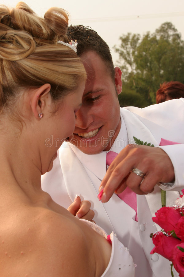 Groom taking out some roses stock images