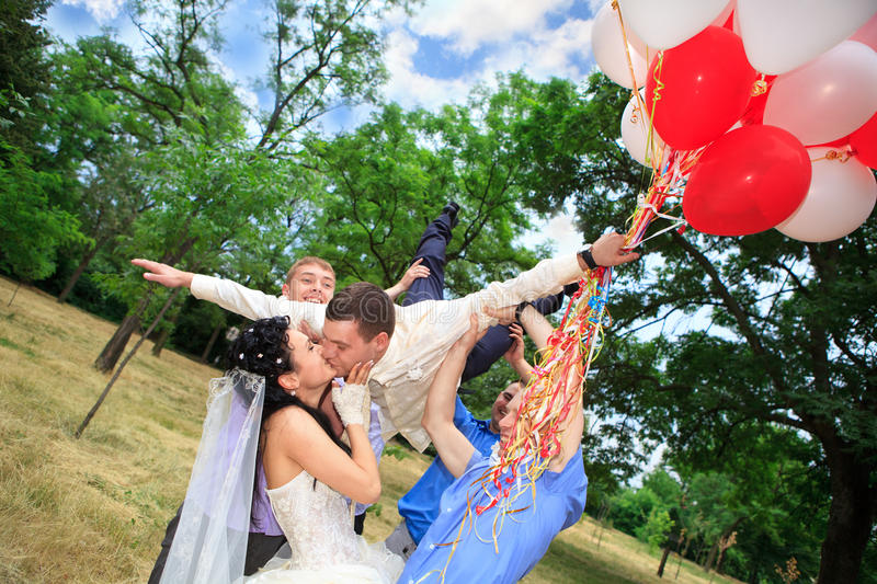 Download Groom tossed into air stock photo. Image of freedom, holding - 24434830