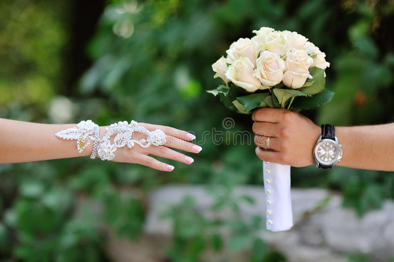 Groom transmits give bride wedding bouquet royalty free stock photos