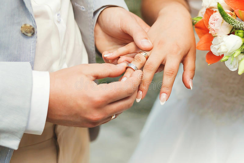 Groom Wearing The Ring On Hand Of Bride Stock Image Image of