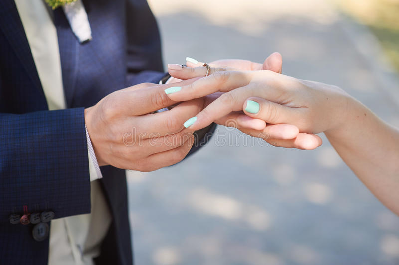Groom Wears Bride A Wedding Ring On Her Finger Stock Photo Image
