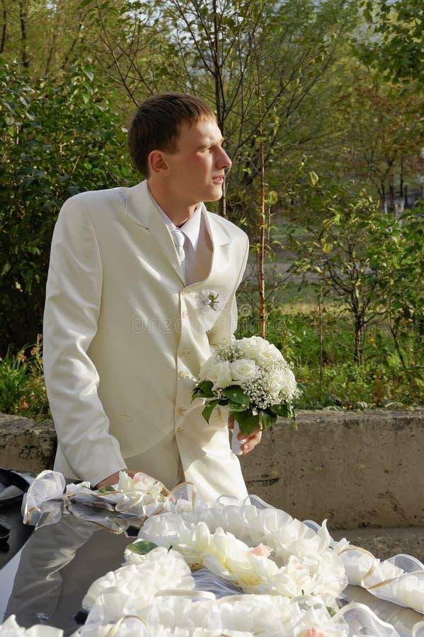 Groom. Wedding. Wedding bouquet in hands of the groom stock image