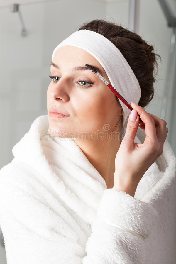 Grooming the eyebrow stock images