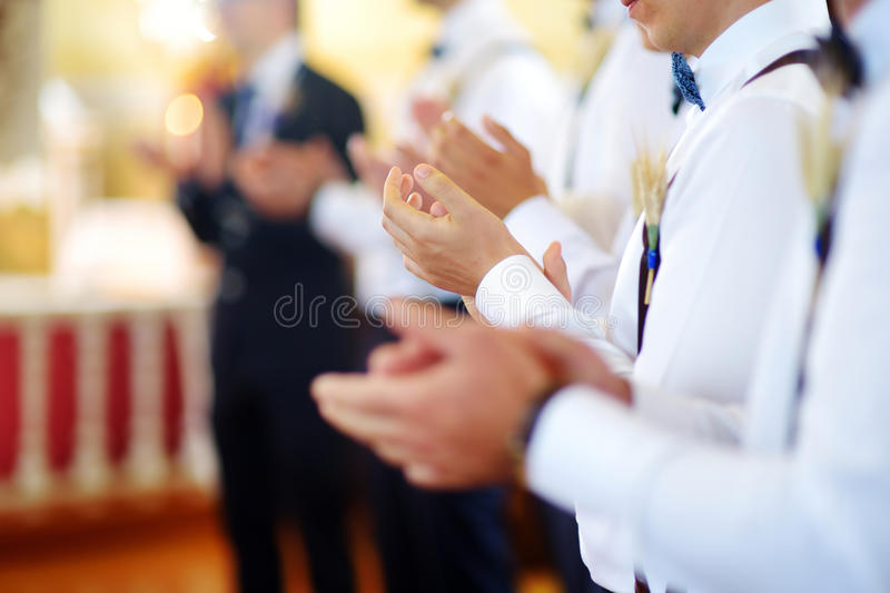 Groomsmen during catholic wedding ceremony royalty free stock image
