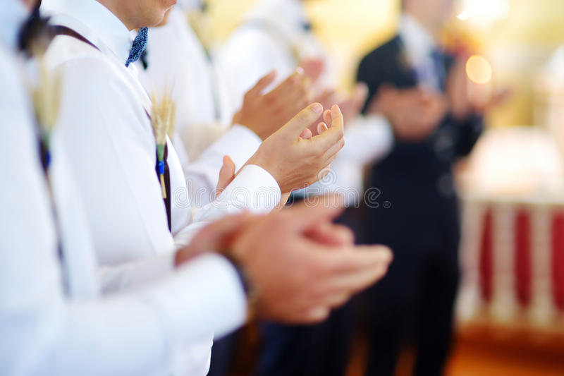Groomsmen during catholic wedding ceremony royalty free stock photos