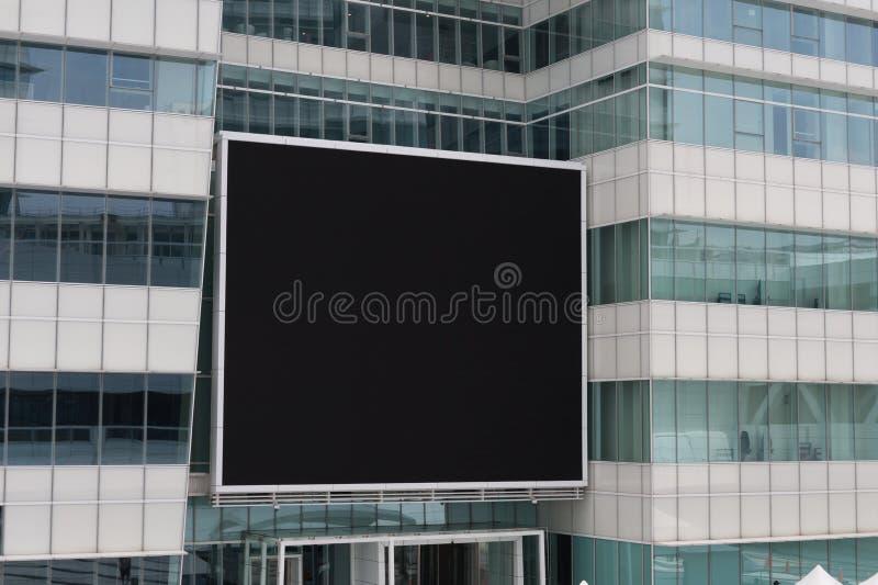 Groot leeg aanplakbord op een straatmuur stock afbeelding
