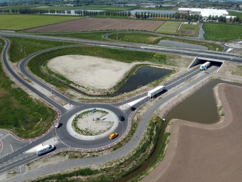 Drone Aerial view taken with a dji spark drone. GROOTEBROEK, THE NETHERLANDS - 10 MEI 2019: Drone aerial photo of a traffic circle with on and off roads for the stock photo