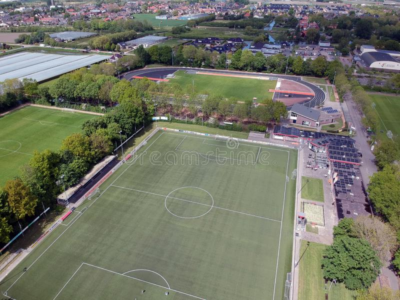 Drone Aerial view taken with a dji spark drone. GROOTEBROEK, THE NETHERLANDS -  10 MEI 2019: Drone Aerial view of a soccer field with billboards all around and royalty free stock photos