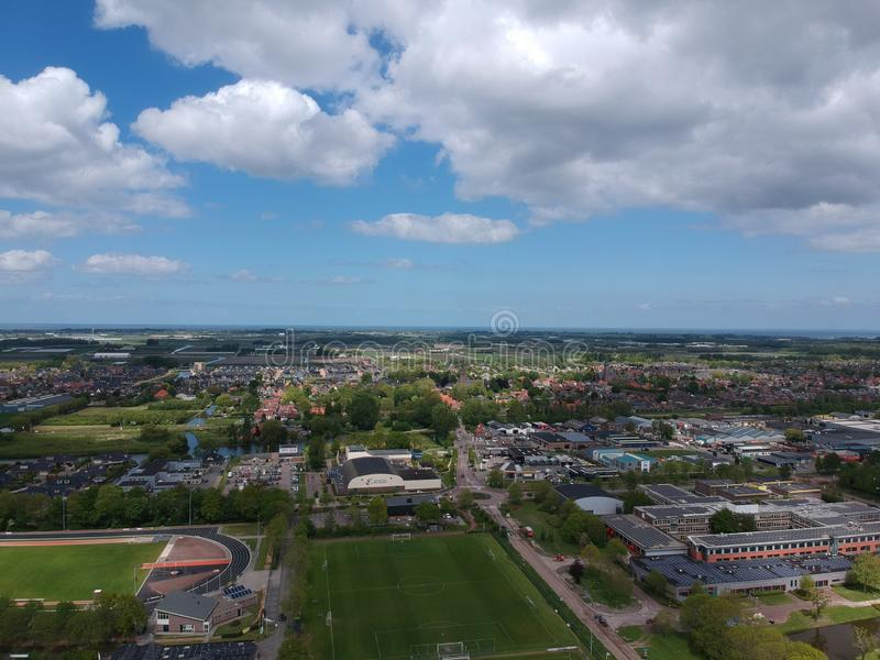 Drone Aerial view taken with a dji spark drone. GROOTEBROEK, THE NETHERLANDS -  10 MEI 2019: Drone Aerial view  of soccer fields and the buildings of the village stock photography