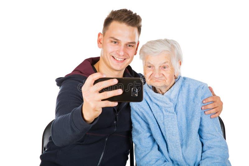 Grootmoeder en kleinzoon stock foto's