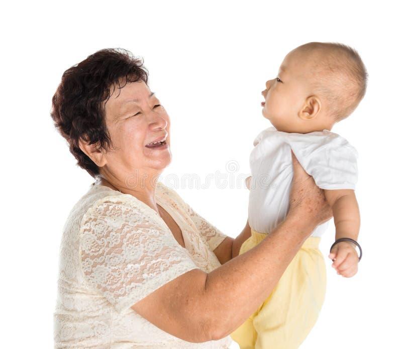 Grootmoeder en kleinzoonportret royalty-vrije stock afbeeldingen