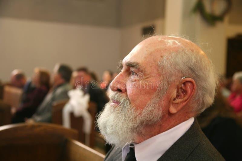 Grootvader in kerk royalty-vrije stock afbeeldingen