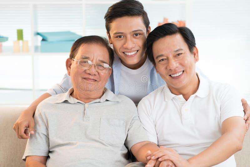 Grootvader, vader en zoon stock foto