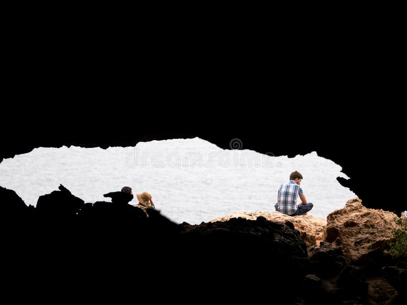 Into the Groove. A guy wtching the sea inside a cove in the cap de barbaria, Formentera royalty free stock photography