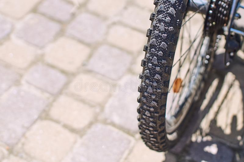 Grooved tire on a mountain bike wheel on a sunny day royalty free stock images