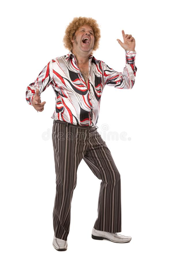 Groovy Disco Man Dancing. A mature adult male at a party letting his hair down and enjoying a dance singing along to the music stock photography