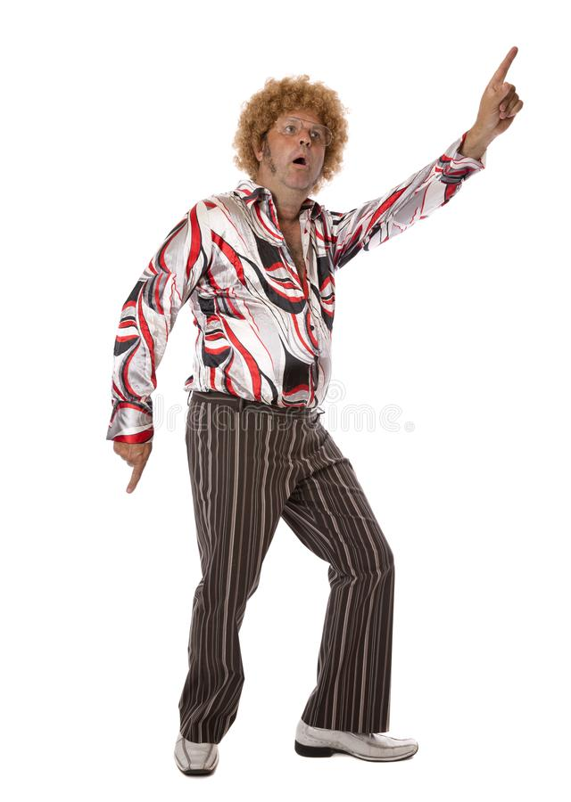 Groovy Disco Man Dancing. A mature adult male at a party letting his hair down and enjoying a dance singing along to the music royalty free stock photos