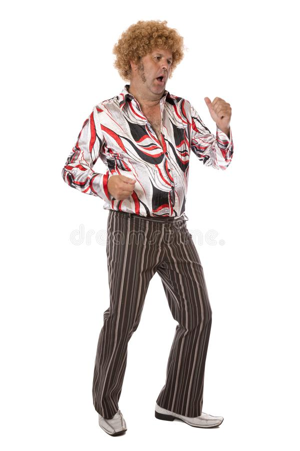 Groovy Disco Man Groovin. A mature adult male at a party letting his hair down and enjoying a dance singing along to the music royalty free stock photo