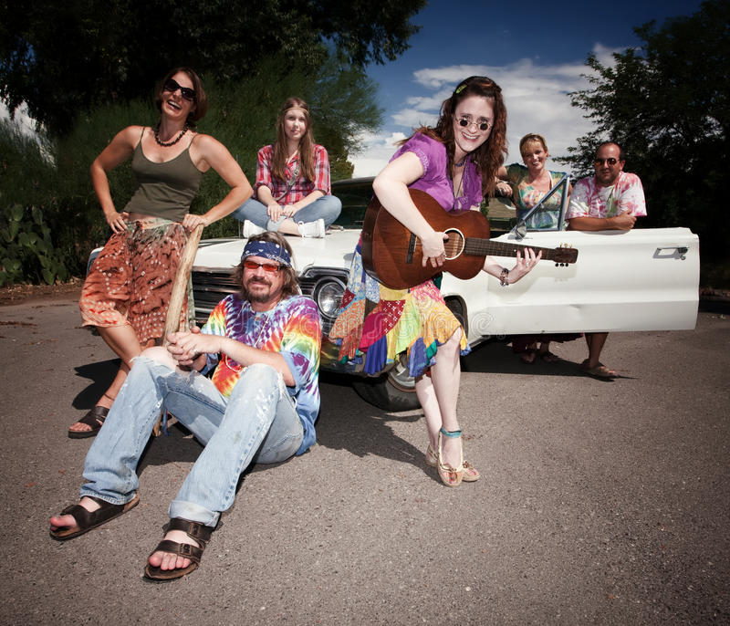 Groovy Group. Mixed group of happy modern adult hippies stock photo