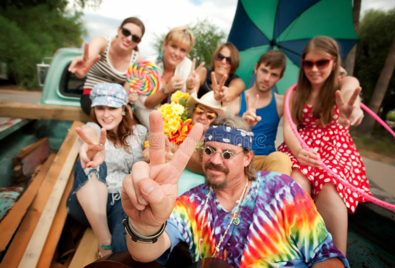 Groovy Group in the Back of Truck. Making Peace Signs stock photography