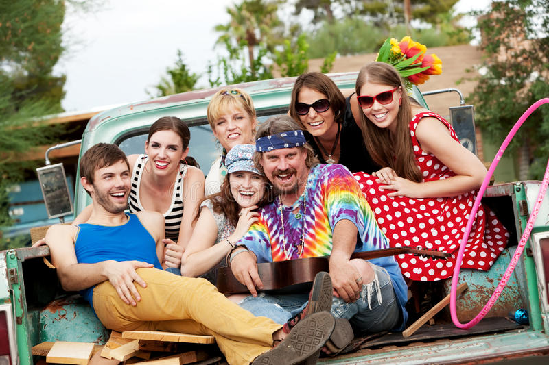 Groovy Group in the Back of Truck. Laughing royalty free stock images