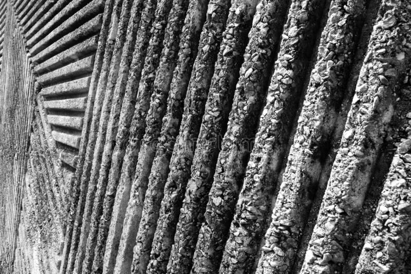 Groovy texture of the concrete wall in the park. Groovy Concrete wall with pattern of lines in the park. Black and White royalty free stock photo