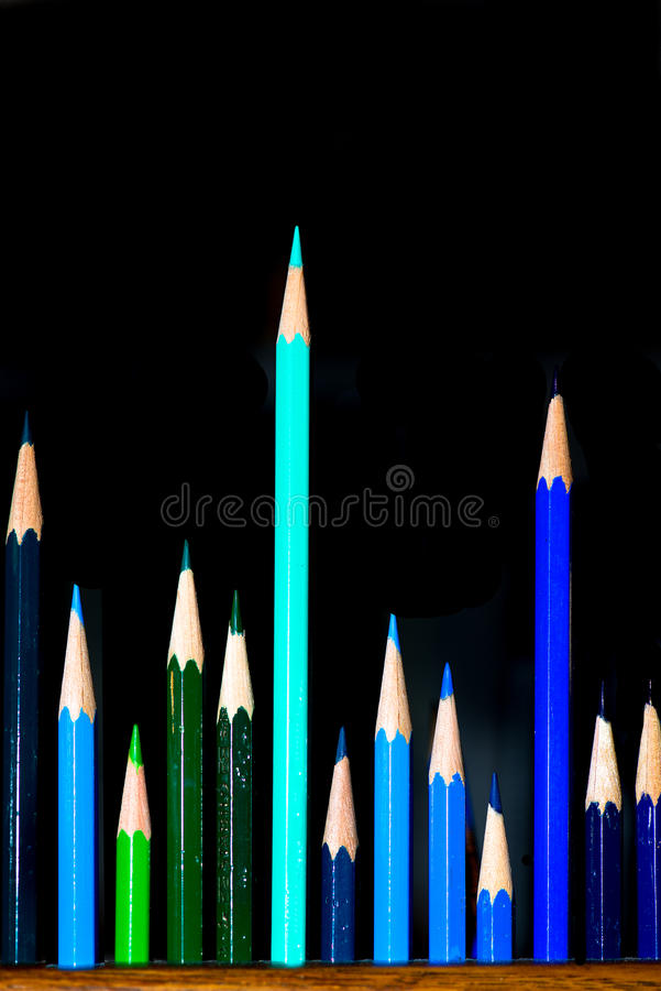Gropup of colored drawing pastel. With dark background and a light royalty free stock images