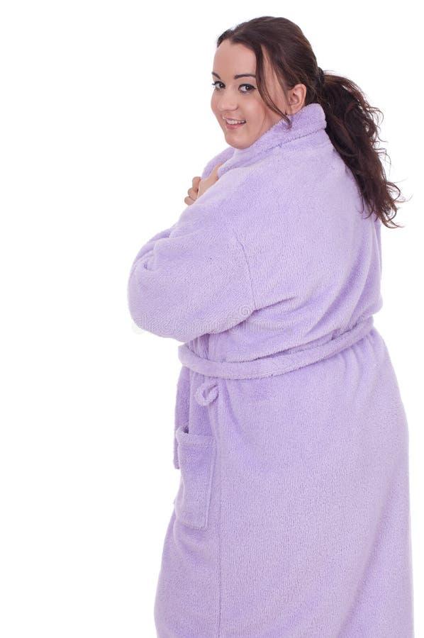 Gros femme dans le peignoir, série photos stock