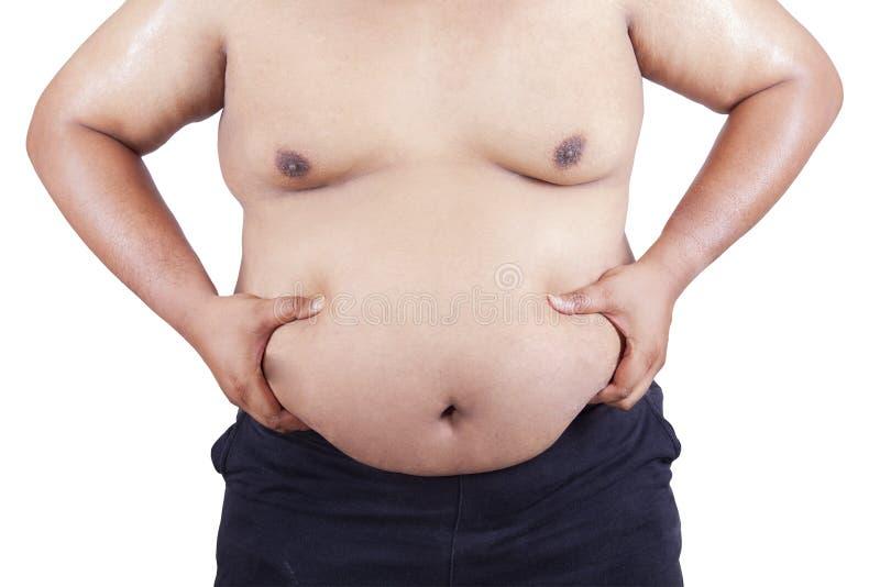 Gros homme tenant son estomac image stock
