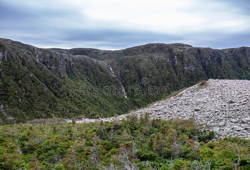 Gros Morne Mountain Summit. Gros Morne Mountain Trail in Gros Morne National Park in Newfoundland, Canada Late fall on a stormy windy day. Mountains and valleys stock images