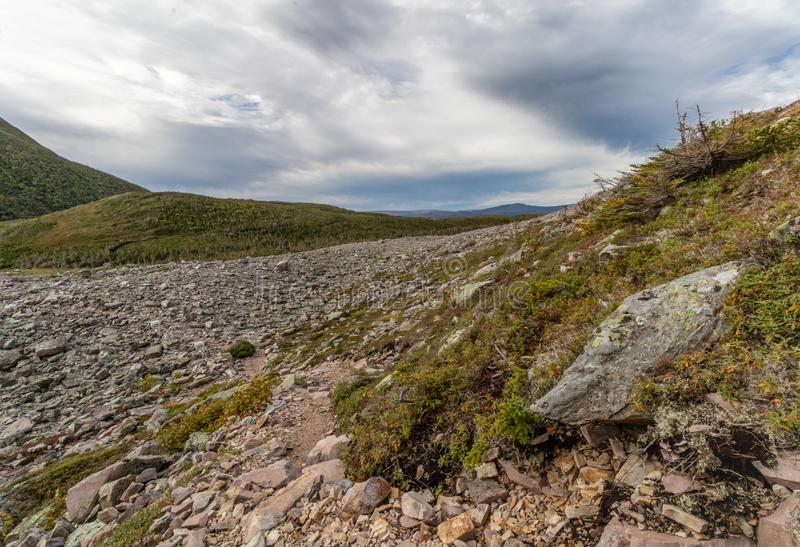 Gros Morne Mountain Terrain. Gros Morne Mountain Trail in Gros Morne National Park in Newfoundland, Canada Late fall on a stormy windy day. Mountains and valleys royalty free stock photography
