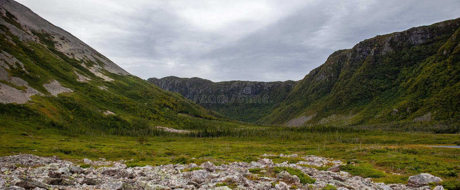 Gros Morne Mountain Valley. Gros Morne Mountain Trail in Gros Morne National Park in Newfoundland, Canada Late fall on a stormy windy day. Mountains and valleys stock image