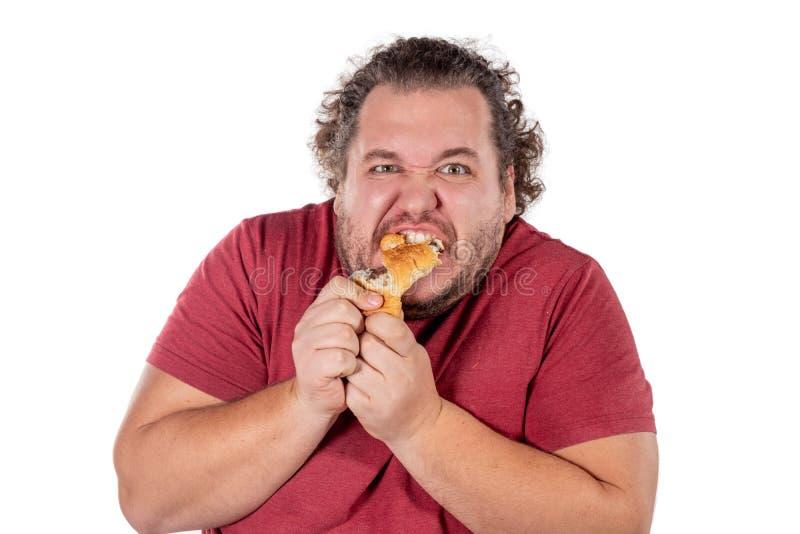 Gros petit croissant mangeur d'hommes drôle sur le fond blanc Bonjour et petit déjeuner photographie stock