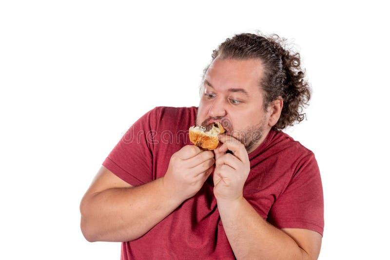 Gros petit croissant mangeur d'hommes drôle sur le fond blanc Bonjour et petit déjeuner photo stock