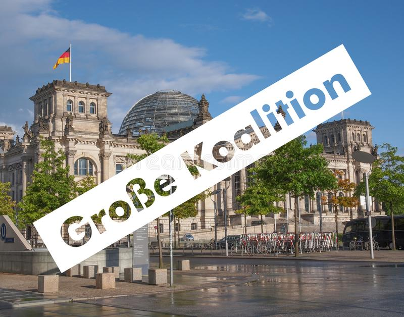 Grosse Koalition over Reichstag-het parlement in Berlijn stock afbeeldingen
