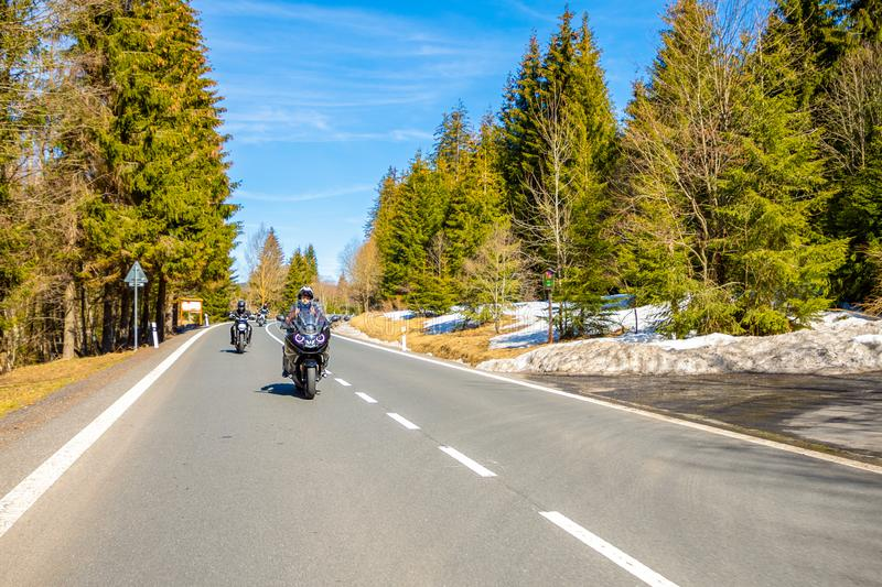 Grosser Arber, Germany - 30.03.2019: Group of motorcyclists bikers riding travelling in formation trough countryside. Germany in Europe royalty free stock photos