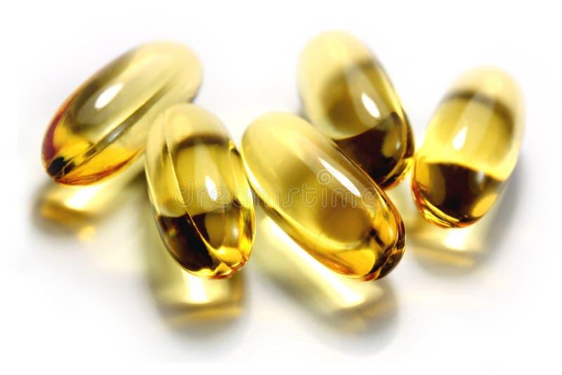 Grosses capsules de pétrole des poissons Omega-3 image libre de droits