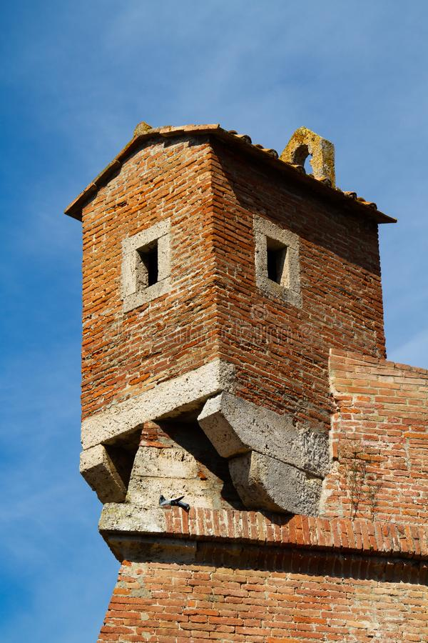 Grosseto, fortress gate. Grosseto, fortress garitta at sunset against a blue sky royalty free stock photo