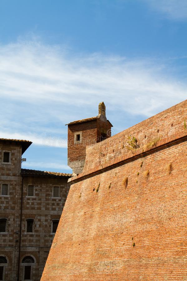 Grosseto, fortress walls. Grosseto, walls and fortress garret at sunset royalty free stock photography